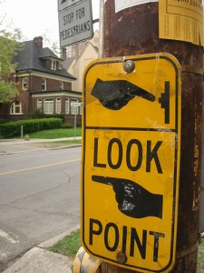 point fingers road sign
