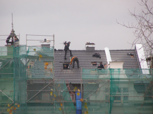 roofers on church