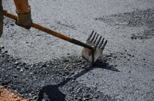 temporary-worker-using-cement-spreader